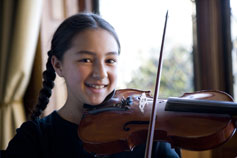 A student practices for the concert in Indonesia.